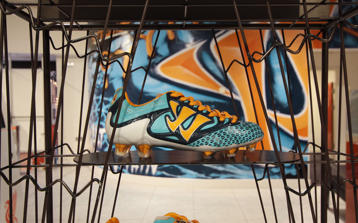 WARRIOR SKREAMER FOOTBALL BOOT IN FRONT OF GRAFFITI MURAL PAINTSHOP